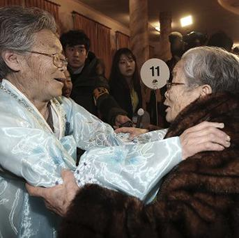 South Korean Kim Sung-yoon, 96, right, meets her North Korean sister Kim Seok Ryu, 80, during the Separated Family Reunion Meeting at Diamond Mountain resort in North Korea (AP)