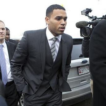 Singer Chris Brown, right, arrives at court in Washington at an earlier hearing (AP)