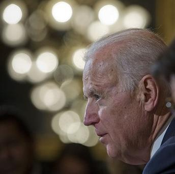 Vice President Joe Biden warned Ukraine's leader the US is prepared to sanction those responsible for the violence in Kiev (AP)