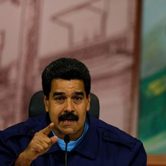 Women supporters of president Nicolas Maduro are planning a march on Saturday in Caracas (AP)
