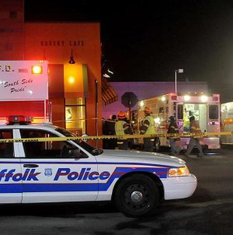 Police and fire personnel respond to a possible case of carbon monoxide poisoning at the Walt Whitman Mall in Huntington, New York (AP)