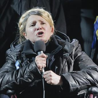 Former Ukrainian prime minister Yulia Tymoshenko addresses the crowd in central Kiev, hours after being released from prison (AP)