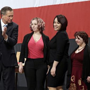 Ohio governor John Kasich introduces, from left, Amanda Berry, Gina DeJesus and Michelle Knight (AP)