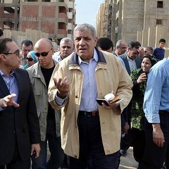 Ibrahim Mehlib, centre, has been named Egypt's new prime minister (AP Photo/Khaled Kandil)