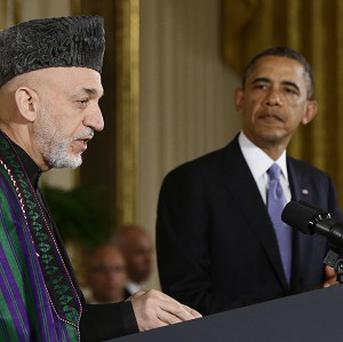 Hamid Karzai, left, is yet to sign a bilateral security agreement with the US (AP Photo/Charles Dharapak, File)