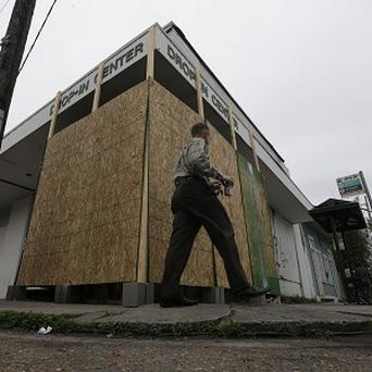 A plywood barrier protects the Banksy mural in New Orleans after an apparent theft attempt (AP)