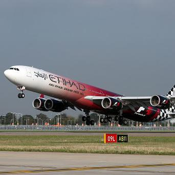 A Etihad Airways Airbus A340 in Abu Dhabi Grand Prix livery takes off at Heathrow Airport