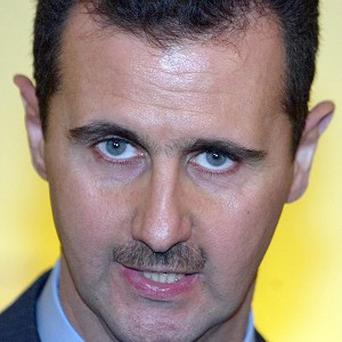 President Bashar Assad's forces are reported to have killed some 175 rebels in an ambush on the outskirts of Damascus