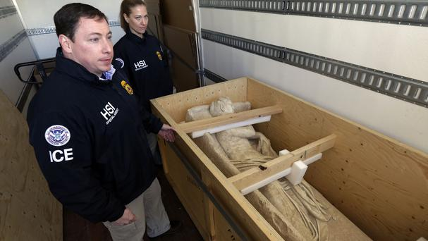 Homeland Security investigators with a crate containing an ancient Roman sculpture seized in New York (AP)