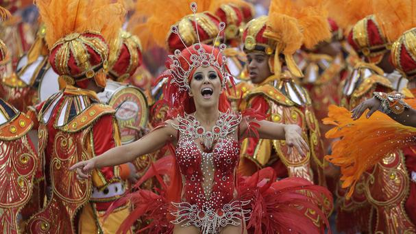 A dancer from a samba school performs during a carnival parade in Brazil (AP)