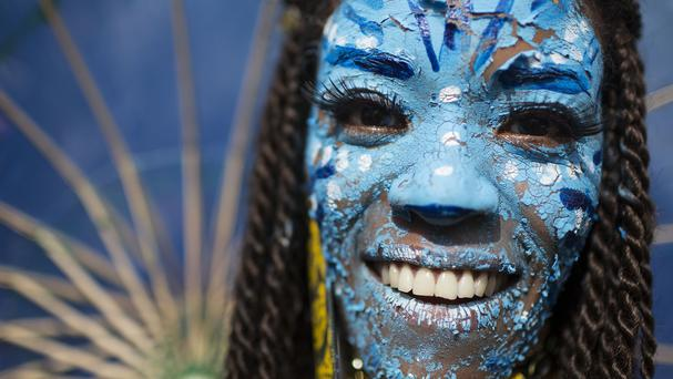 A reveller dressed as a character from the movie Avatar during carnival celebrations in Rio (AP)