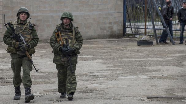 Soldiers of the armed forces of Ukraine walk near the general staff headquarters in Sevastopol (AP)