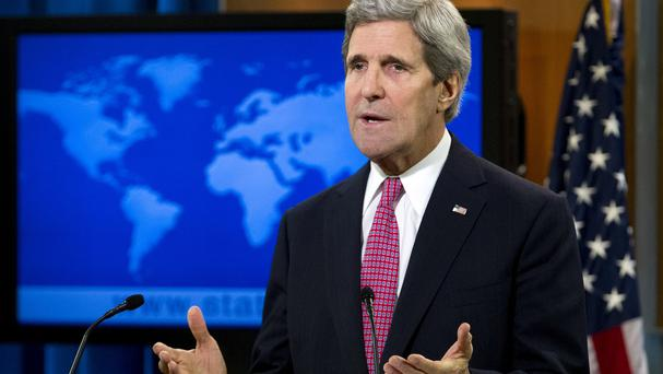 US Secretary of State John Kerry has warned Russia faces sanctions over its incursioin into Ukraine