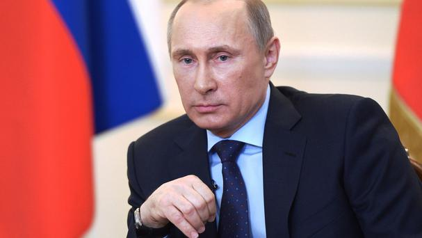 President Vladimir Putin said Moscow reserves the right to use all means to protect Russians in Ukraine (AP)