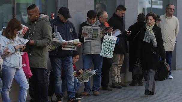 People queue to enter an unemployment registry office in Madrid, Spain. (AP)