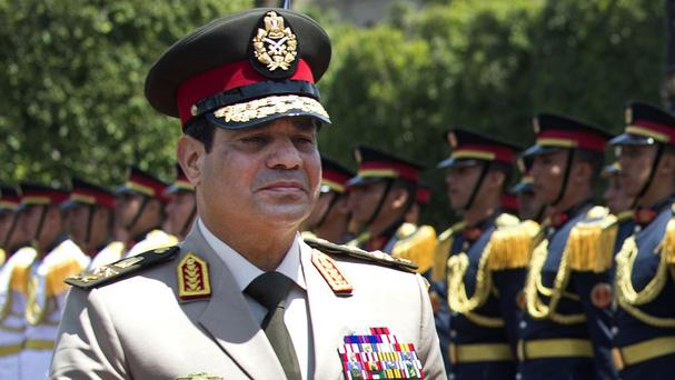 Egypt's military chief Field Marshal Abdel-Fattah el-Sissi has hinted he will run in the presidential elections (AP)