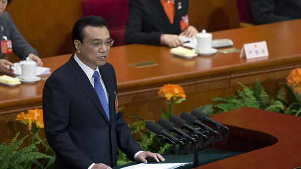 Chinese premier Li Keqiang speaks during the opening session of the annual National People's Congress in Beijing (AP)
