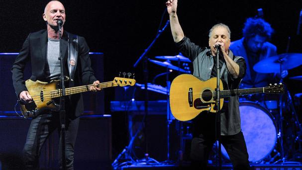 Musicians Sting, left, and Paul Simon perform together in concert at Madison Square Garden (AP)