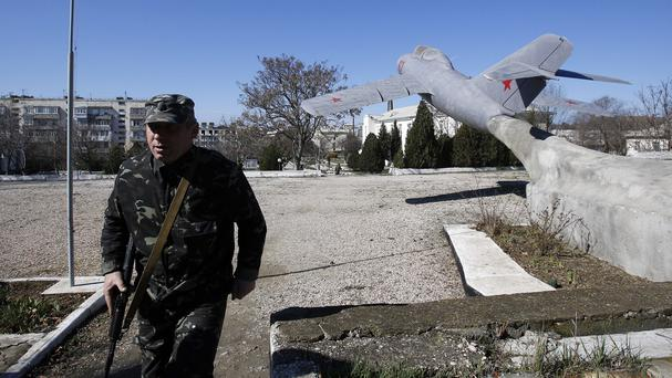 Ukrainian soldiers guard the military base at the Black Sea port of Sevastopol in Crimea (AP)