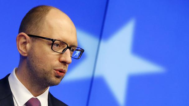 Ukraine's Prime Minister Arseniy Yatsenyuk speaking to the media at the EU summit in Brussels (AP)