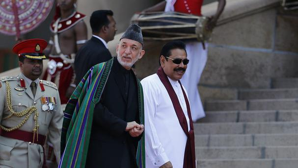 Afghan President Hamid Karzai, left, seen with Sri Lankan President Mahinda Rajapaksa, has criticised Nato over civilian deaths in strikes in his country