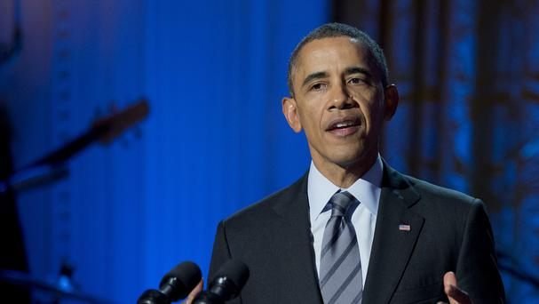 Barack Obama discussed the Ukraine crisis in a phone call with Japan prime minister Shinzo Abe (AP)
