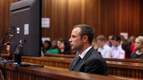 Oscar Pistorius sits in the dock during his murder trial at the high court in Pretoria (AP)