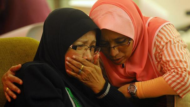 Family members of passengers wait for news in Putrajaya, Malaysia (AP)