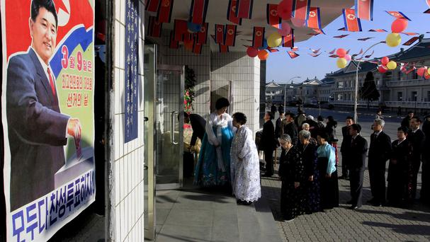 Voters line up to cast their ballots in Pyongyang (AP)