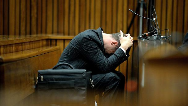 Oscar Pistorius reacts to evidence detailing the injuries to Reeva Steenkamp (AP)