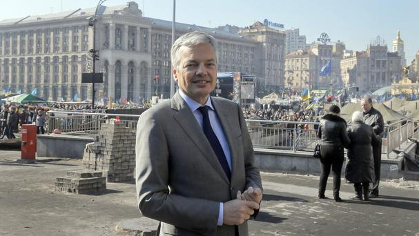 Belgium's foreign minister Didier Reynders toured Independence Square in Kiev as part of a visit to Ukraine (AP)