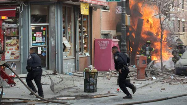 Emergency crews respond to an explosion that levelled two apartment buildings in East Harlem, New York (AP)