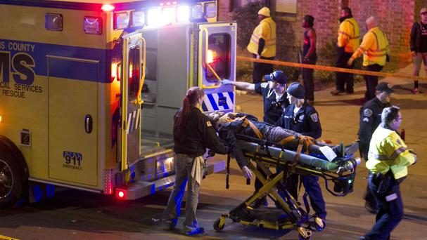 A man is taken for treatment after being struck by a vehicle on Red River Street in Austin, Texas, during the South By Southwest festival (AP)