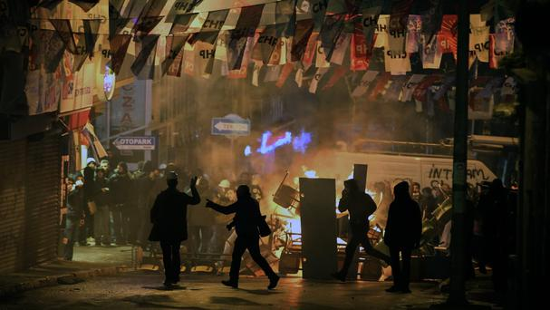 Demonstrators clash with riot police following the funeral of Berkin Elvan (AP)