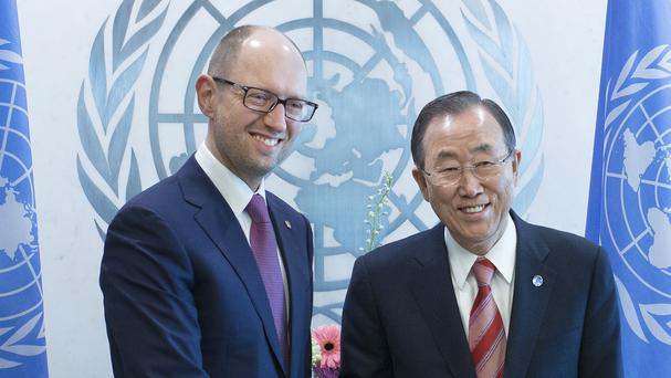 Ukrainian PM Arseniy Yatsenyuk met with UN Secretary-General Ban Ki-moon on Thursday (AP)