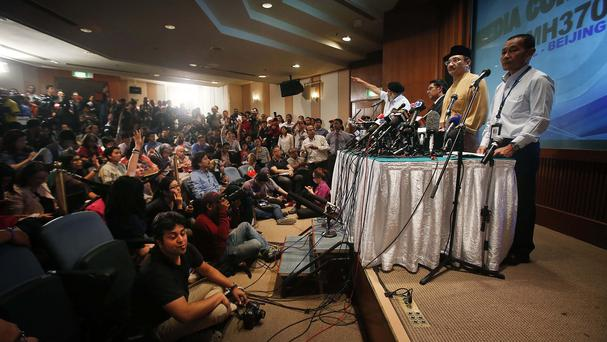 Malaysian transport minister Hishamuddin Hussein, centre, joins a press conference about the search in Sepang, Malaysia (AP)