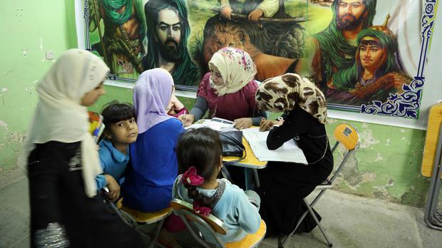 Girls study at an orphanage in Baghdad. A new law set to be introduced in Iraq could see girls as young as nine being married.