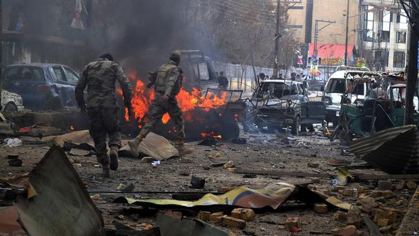 Soldiers of the Pakistani paramilitary force on the scene of the Quetta bombing (AP)