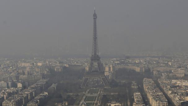 The Eiffel Tower in Paris is barely visible through the smog (AP)