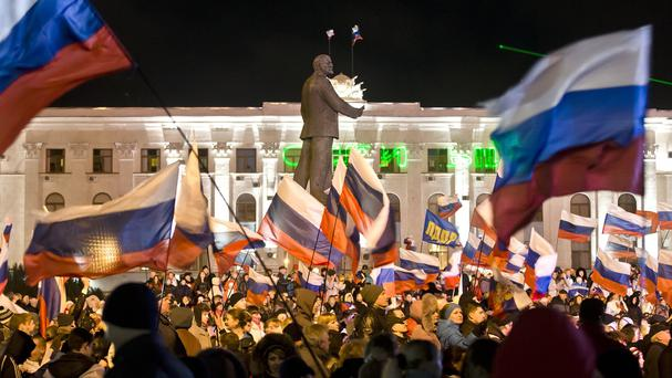 Pro-Russian people celebrate in Lenin Square in Simferopol, Ukraine, after polls closed in Crimea's contentious referendum. (AP)