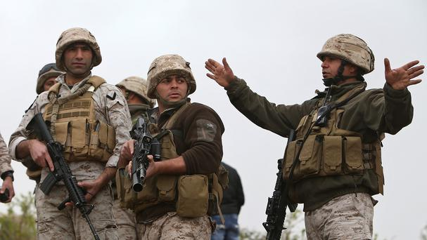 Lebanese army officers near the Lebanese and Syria border in northeast Lebanon (AP Photo/Hussein Malla)