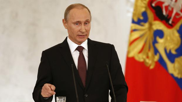 Russia's President Vladimir Putin addresses the Federation Council in Moscow's Kremlin