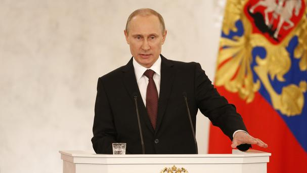 President Vladimir Putin gives an address in the Kremlin defending Russia's move to annex Crimea (AP)
