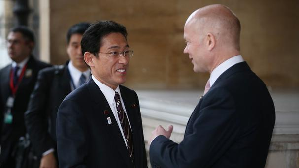 Fumio Kishida (left), pictured with Foreign Secretary William Hague, said Japan does not recognise Crimea's referendum