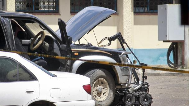 A remotely controlled robot of the Kenya Defence Forces examines a suspect vehicle. (AP)