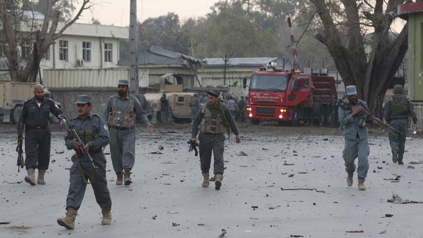 Afghan army and police after an attack on a police station in Jalalabad (AP)