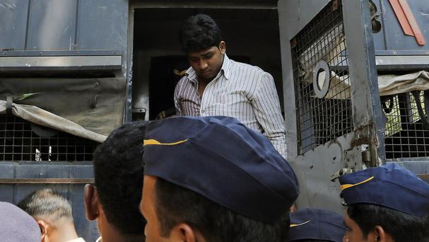 One of four men convicted of gang raping a photojournalist in India's financial capital of Mumbai is brought to prison (AP)