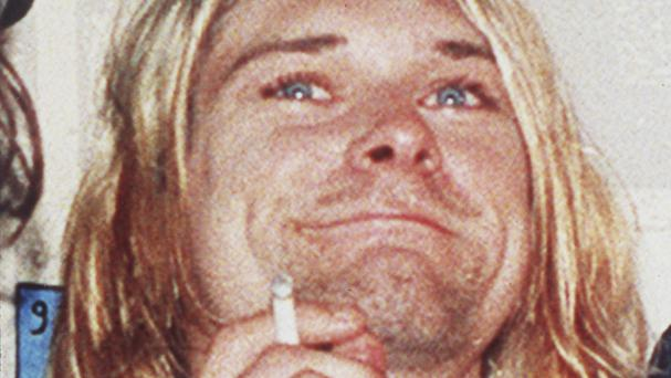 Seattle police plan to release new photographs discovered during a re-examination of the death of Nirvana's Kurt Cobain (AP)