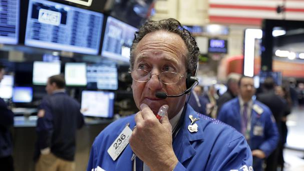 Trader Steven Kaplan works on the floor of the New York Stock Exchange, which saw stocks rise on the first day of spring (AP)