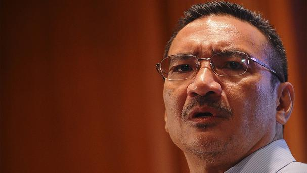 Malaysian Defence Minister Hishammuddin Hussein answers a question of a journalist during a press conference at a hotel in Sepang (AP)